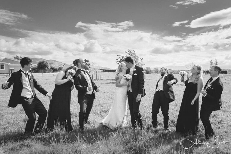 Image of bridal party in the Martinborough fields at Brackenridge taken by Alicia Scott - Wairarapa wedding photographer