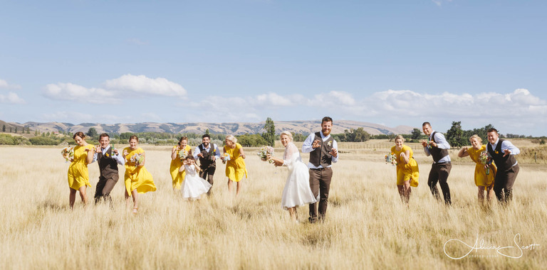 Image of bridal party in the Martinborough fields taken by Alicia Scott - Wairarapa wedding photographer