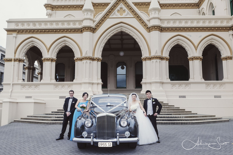 Photo of wedding party outside the old Parliamentary Library taken by Alicia Scott, Wellington wedding photographer