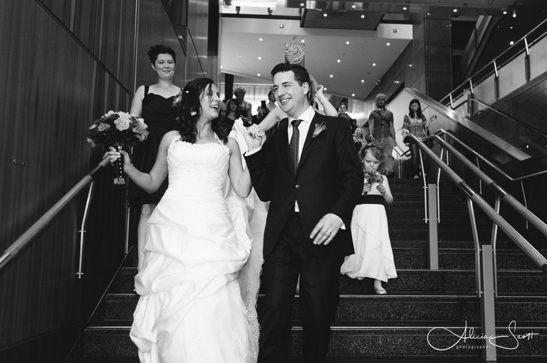 Photo of wedding couple leaving Te Papa taken by Alicia Scott, Wellington wedding photographer