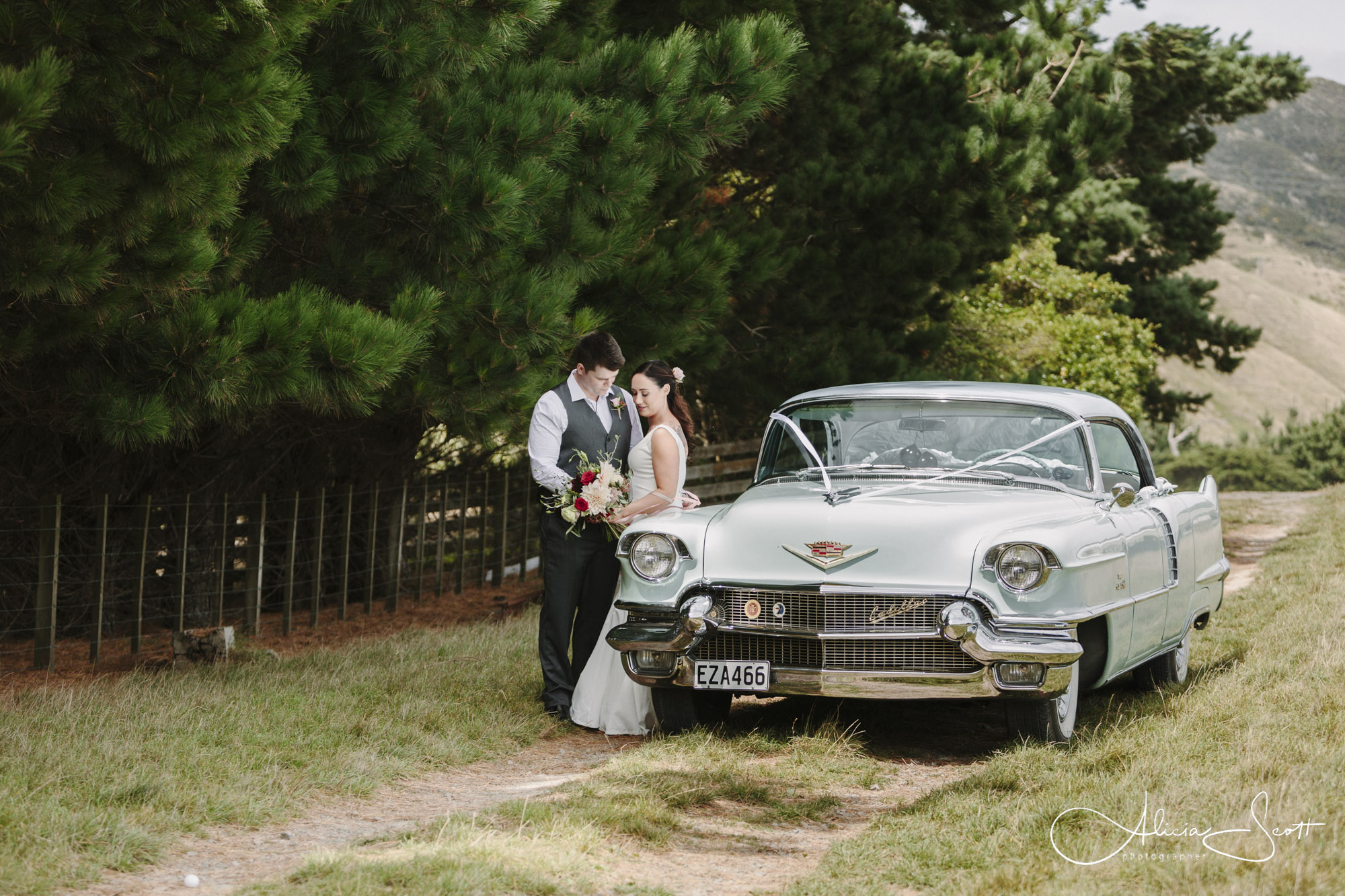 Images from the windy Ohariu Farm wedding of Zach and Kathryn taken by Alicia Scott Wellington Photographer