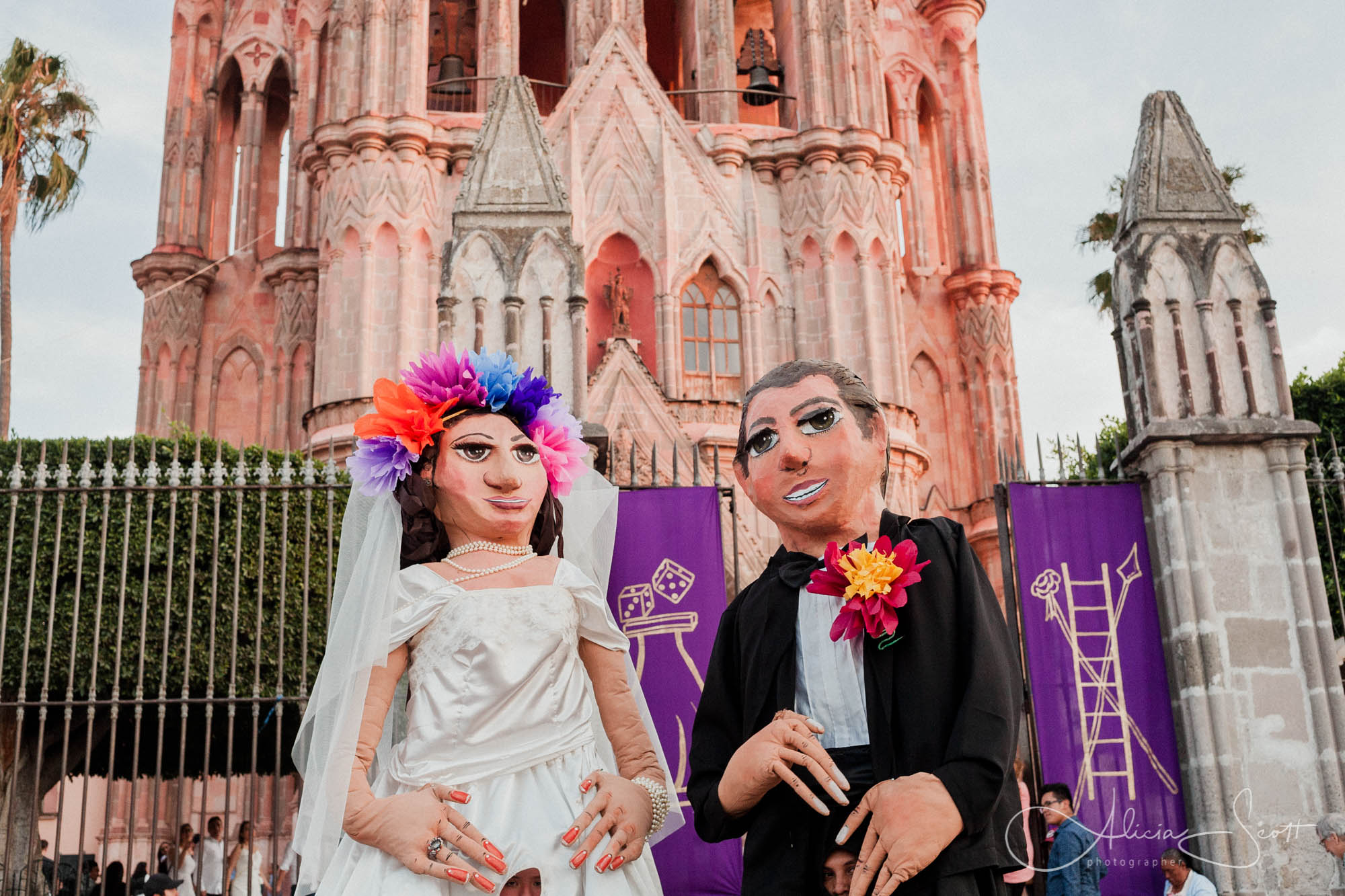 Bride and groom mojiganga puppets outside La Parroquia in San Miguel Allende