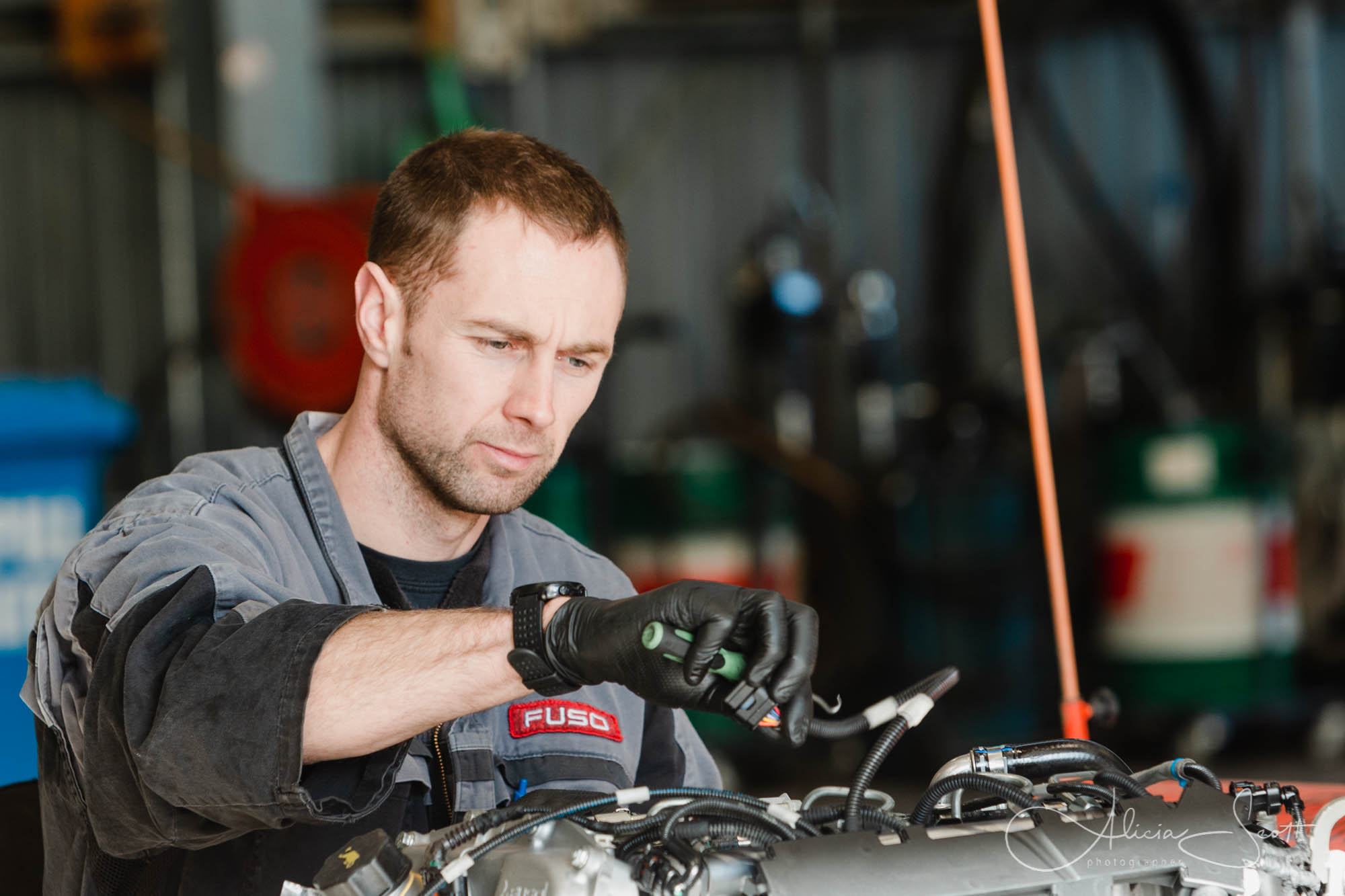 Image of a mechanic at work as part of business in action shots for DESL taken by Alicia Scott Petone Photographer
